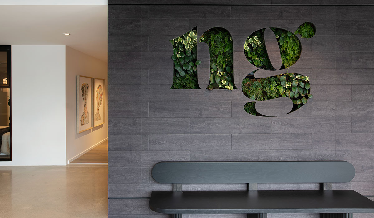 Norwood Green plant logo wall by Algo Más